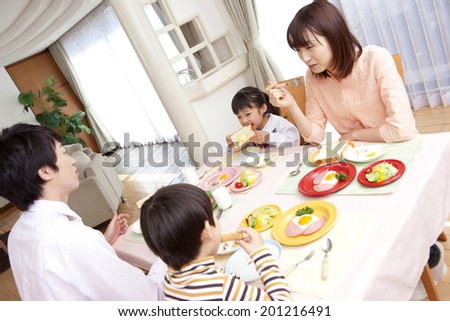 Parent and child eating breakfast - stock photo