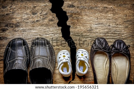 Parent and child shoes - Divorce - stock photo