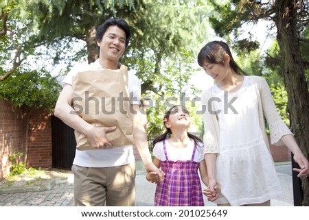 Parent and child who came back from shopping - stock photo