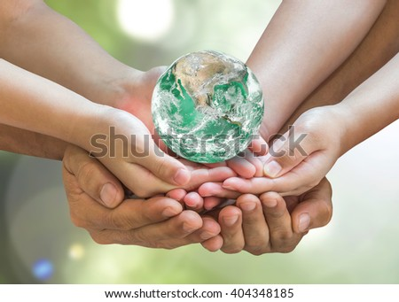 Parent and children holding together green bio earth globe on person hands on blur nature greenery background sun flare Save clean environment CSR ESG concept Elements of this image furnished by NASA - stock photo
