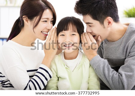 parent and daughter whispering gossip - stock photo