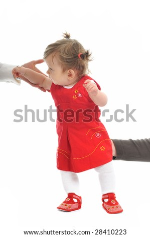 parent help and support baby  to make first step isolated on white - stock photo