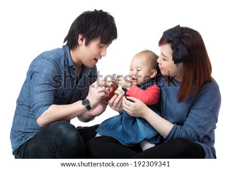 Parent play with baby daughter - stock photo