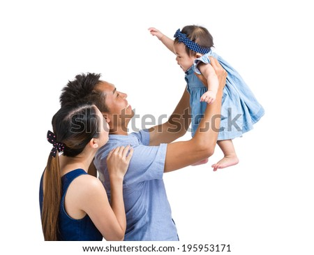 Parent playing with baby girl - stock photo