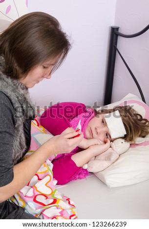 Parent problem with sick child - stock photo