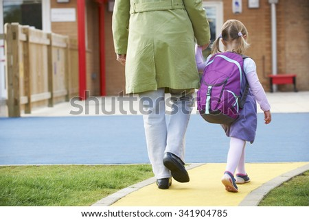 Parent Taking Child To Pre School - stock photo