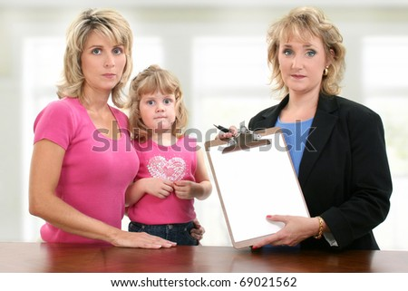 Parent teacher conference meeting at school with unhappy mom, child and teacher.  Teacher holding blank paper towards camera. - stock photo