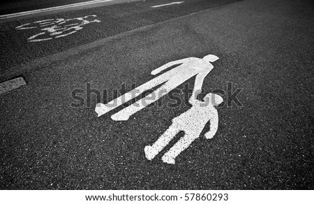 parental guidance concept - pedestrian sign on the  pavement/sidewalk - stock photo