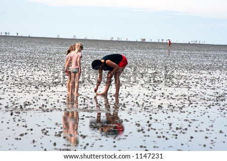 Parenting at the beach - stock photo