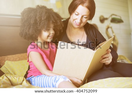 Parenting Mother Child Love Reading Concept - stock photo