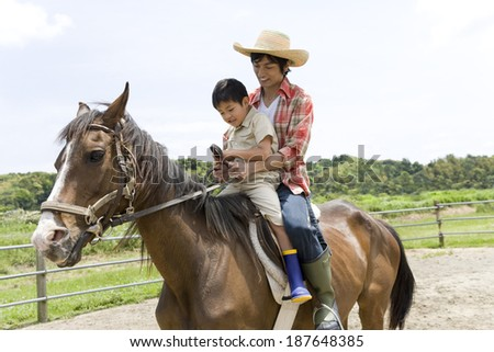 parents and child experiencing horse riding