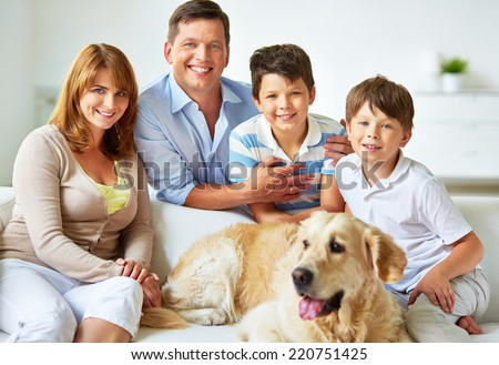 Parents and children with their pet - stock photo