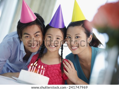 Parents and Daughter Having Birthday Party - stock photo