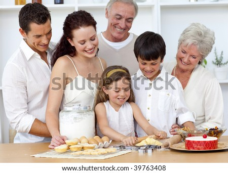 Parents and grandparents looking at children baking
