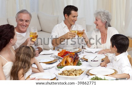Parents and grandparents tusting with wine in a family dinner - stock photo