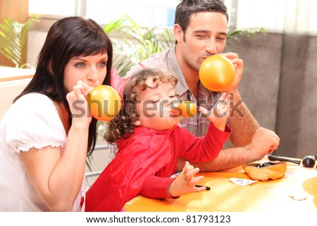 Parents and little boy preparing Halloween party - stock photo