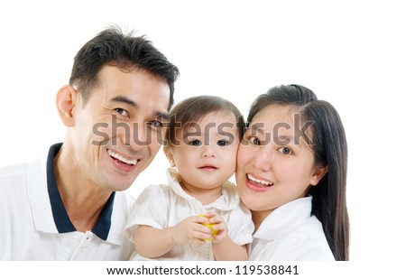 parents and their beautiful baby girl - stock photo