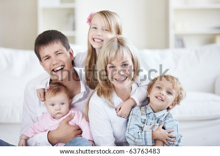 Parents and three children at home - stock photo