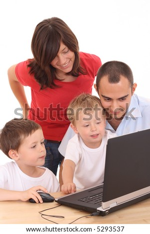 parents and two sons having fun with computer game isolated on white - stock photo