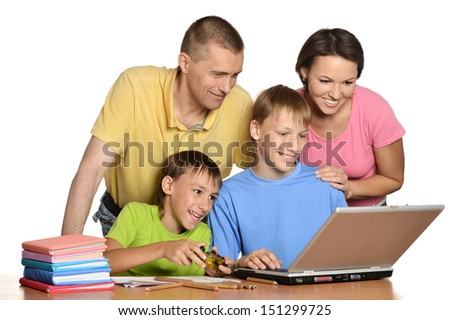 Parents and two sons playing on the computer - stock photo