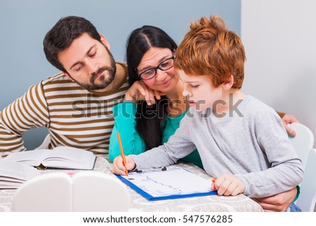 Parents are teaching their son at home.