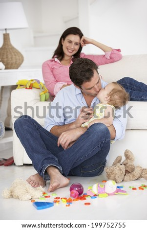 Parents at home with baby girl - stock photo