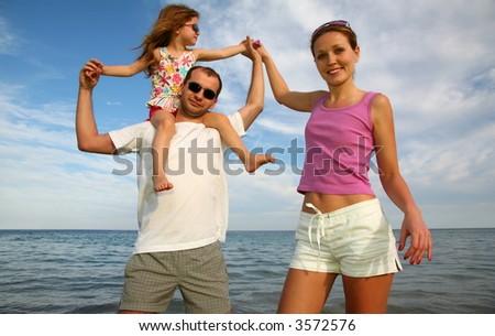 parents baby sea - stock photo