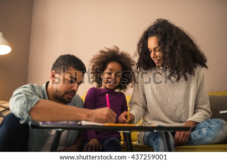 Parents drawing with their little girl. - stock photo