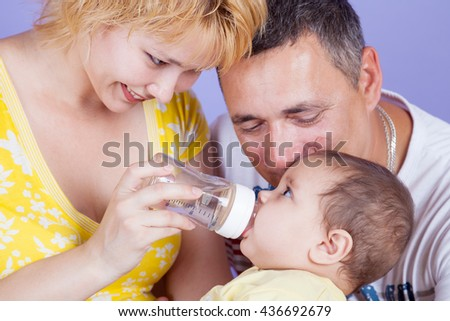 parents fed by baby bottle food feeding parent beautiful - stock photo