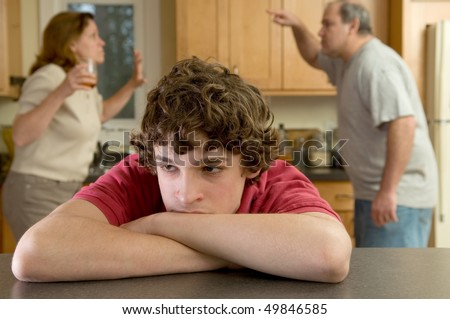 parents fight, son suffers - stock photo