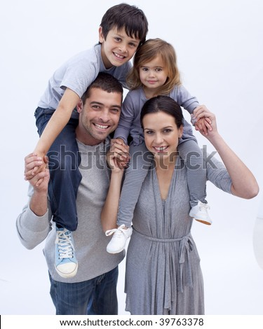 Parents giving children piggyback rides at home - stock photo