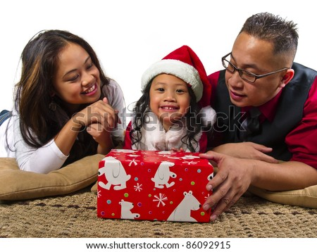 parents giving the child a Christmas gift