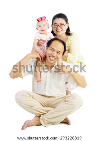 Parents having piggyback fun with their lovely daughter. - stock photo