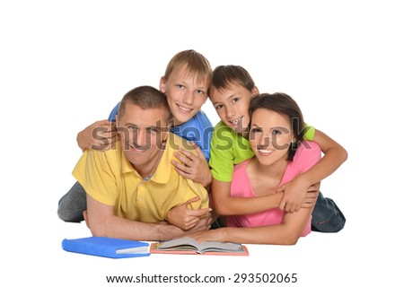 Parents help children do their homework on the floor - stock photo