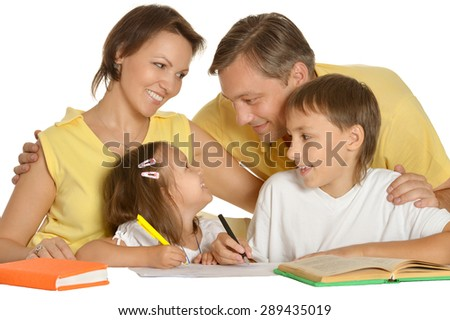 Parents help children with homework on white background - stock photo