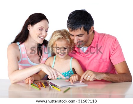 Parents helping their daughter doing homework at home - stock photo