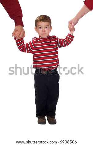 Parents holding boy's hands isolated over a white background