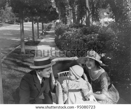 Parents on walk with baby - stock photo