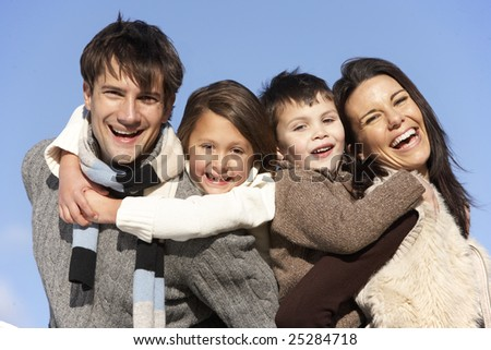 Parents Piggy Backing Their Children - stock photo