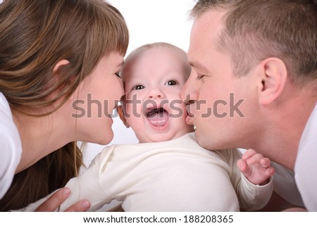 Parents play with newborn baby at home. Happy family. - stock photo