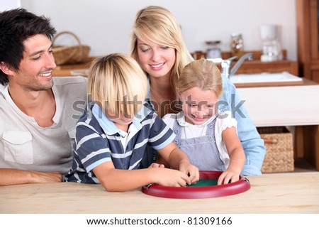 parents playing with their kids - stock photo