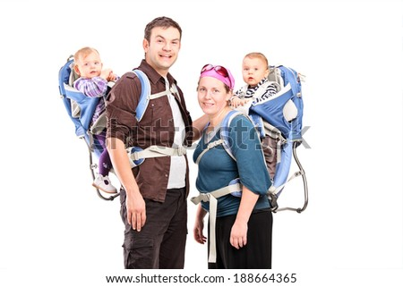 Parents posing with their babies isolated on white background - stock photo