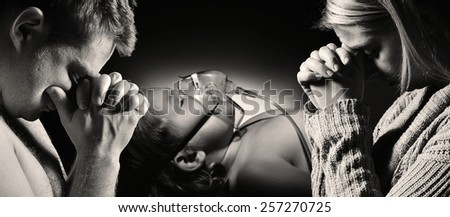 Parents pray for the health of seriously ill daughter. MANY OTHER PHOTOS FROM THIS SERIES IN MY PORTFOLIO.  - stock photo