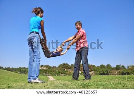 parents shake their son, fun - stock photo