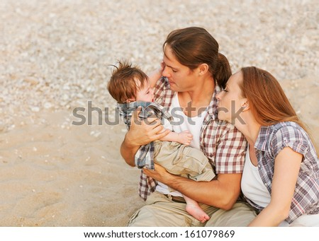parents soothe a crying baby - stock photo