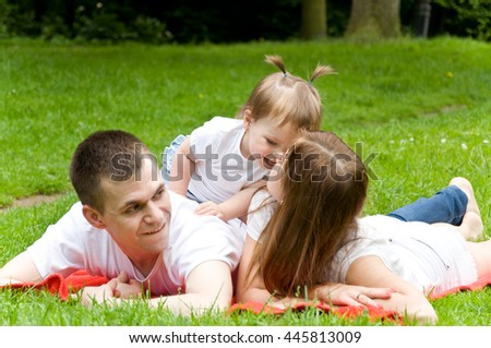 parents spend the weekend. daughter whispering something in the ear of her mother. Dad listens carefully to them - stock photo