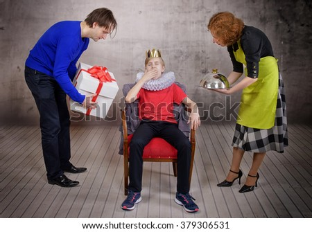 Parents try hard to please their son. Parenting style concept - stock photo