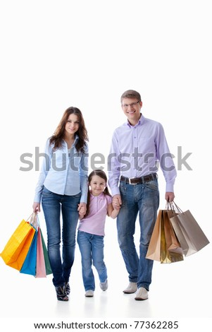 Parents with a child with shopping on white background - stock photo