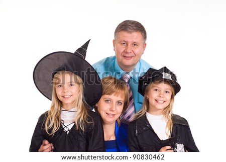 parents with children dressed in Halloween costumes - stock photo