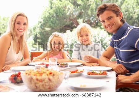 Parents, with children, enjoy a picnic - stock photo